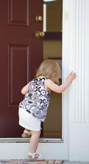 child entering open doorway